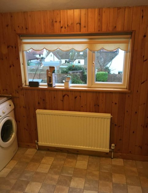 wood panelling utility room before kitchen renovation